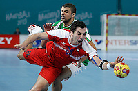 Algeria's Hichem Daoud (b) and Egypt's Ahmed Mostafa during 23rd Men's Handball World Championship preliminary round match.January 15,2013. (ALTERPHOTOS/Acero) /NortePhoto