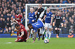 Theo Walcott of Everton is challenged by Dejan Lovren of Liverpool during the premier league match at Goodison Park Stadium, Liverpool. Picture date 7th April 2018. Picture credit should read: Robin Parker/Sportimage