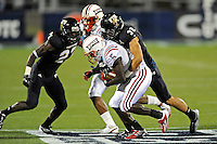 12 November 2011:  FIU defensive back Justin Halley (32) tackles Florida Atlantic running back Willie Floyd (5) in the first quarter as the FIU Golden Panthers defeated the Florida Atlantic University Owls, 41-7, to win the annual Shula Bowl game, at FIU Stadium in Miami, Florida.