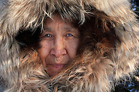 Bettles, Arctic Circle, Alaska 2006. Jean Stevens, native Eskimo woman. I was photographing a story on the coldest places on the planet, Bettles being one of them. It was so cold my eyelashes froze. The northern light show was breathtaking but living here is not for the faint of heart. Jean, at 77-years-old, still runs the local post office and tears around on her snow mobile delivering mail.