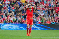 Gareth Bale of Wales re-ties his hair during the FIFA World Cup Qualifier match between Wales and Georgia at the Cardiff City Stadium, Cardiff, Wales on 9 October 2016. Photo by Mark  Hawkins / PRiME Media Images.