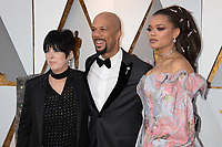 Oscar&reg; nominee Diane Warren with Common and Andra Day arrives on the red carpet of The 90th Oscars&reg; at the Dolby&reg; Theatre in Hollywood, CA on Sunday, March 4, 2018.<br /> *Editorial Use Only*<br /> CAP/PLF/AMPAS<br /> Supplied by Capital Pictures