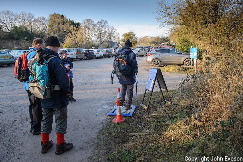 Visitors to RSPB Leighton Moss, Lancashire using a disinfectant pad when leaving the reserve after the discovery of a dead bird with bird flu.