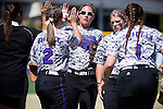 21 MAY 2016:  Shortstop Reagan Tittle (22) of the University of North Alabama gets high fives after a nice play against Humboldt State University during the Division II Women's Softball Championship held at the Regency Athletic Complex on the Metro State University campus in Denver, CO.  North Alabama defeated Humboldt State 4-1 to win the national title.  Jamie Schwaberow/NCAA Photos