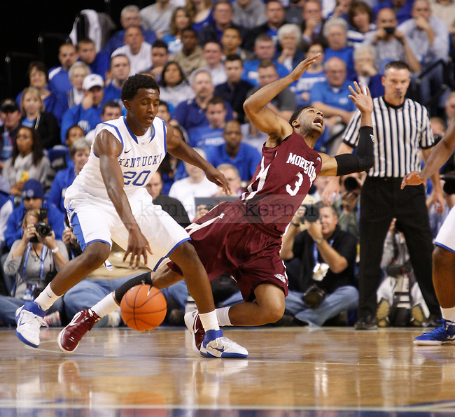 Morehouse forward Daniyal Faquir looks to draw a foul, but sophomore guard Doron Lamb draws the fouls during the first half of the UK's home game against Morehouse in Lexington, Ky., Nov. 7, 2011. Photo by Brandon Goodwin | Staff