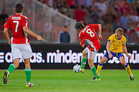 Hungary's Gergely Rudolf (L) and Sweden's Sebastian Larsson (R)fight for the ball during the UEFA EURO 2012 Group E qualifier Hungary playing against Sweden in Budapest, Hungary on September 02, 2011. ATTILA VOLGYI