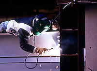WELDING: OXYACETYLENE TORCH<br /> (Variations Available)<br /> Welder At Work<br /> Welding is a fabrication process that joins materials, usually metals or thermoplastics, by causing coalescence.  This is often done by melting the workpieces and adding a filler material to form a pool of molten material that cools to make a strong joint