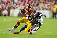 Landover, MD - August 24, 2018: Washington Redskins tight end Vernon Davis (85) gets tackled Denver Broncos defensive back Dymonte Thomas (35) during the preseason game between Denver Broncos and Washington Redskins at FedEx Field in Landover, MD.   (Photo by Elliott Brown/Media Images International)
