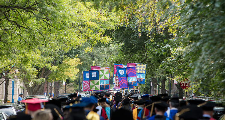 Faculty and staff process down Belden Ave. before the 120th DePaul University Convocation on Thursday, August 31, 2017, at St. Vincent de Paul Parish Church. DePaul University President A. Gabriel Esteban, Ph.D., and Marten denBoer, provost, provided remarks, and many faculty and staff were recognized with annual awards including: Excellence in Teaching, Spirit of Inquiry, Excellence in Public Service, Vincent de Paul Professorship, Spirit of DePaul, Staff Quality Service, Gerald Paetsch Academic Advising and faculty promotion and tenure. (DePaul University/Jeff Carrion)