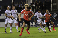 Cameron McGeehan of Luton Town celebrates his winning penalty during the Sky Bet League 2 match between Luton Town and Newport County at Kenilworth Road, Luton, England on 16 August 2016. Photo by Liam Smith.