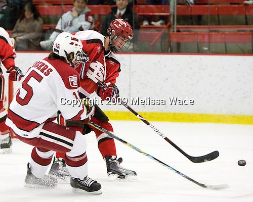 Doug Rogers (Harvard - 15), George Hughes (St. Lawrence - 15) - The St. Lawrence University Saints defeated the Harvard University Crimson 3-2 on Friday, November 20, 2009, at the Bright Hockey Center in Cambridge, Massachusetts.
