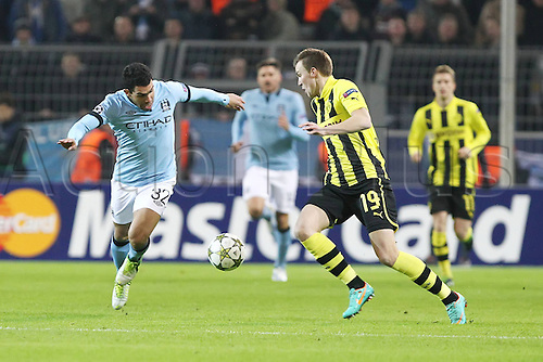 04.12.2012. Dortmund, Germany.  Carlos Tevez Manchester City left in challenge with Kevin Grosskreutz Borussia Dortmund Champions League Borussia Dortmund vs Manchester City