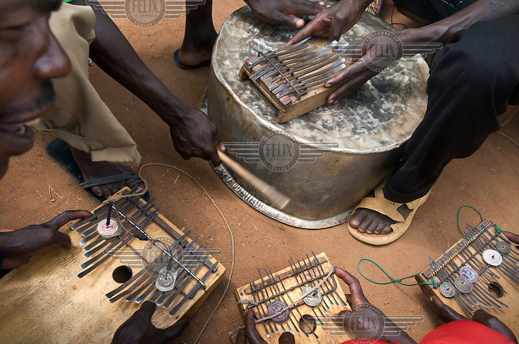 Traditional musicians play finger pianos.