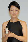 Actresse Kanako Higuchi, 50, poses with SoftBank?s premium mobile handset SoftBank 823SH Tiffany. Ueto and Higuchi appear in Softbank TV commercials as daughter and mother. The Tiffany model features 537 diamonds?18.34 carats in total. Ten handsets will be sold for 11.298 million yen each. The handset will be displayed at Softbank?s shop in Omotesando from Nov 1 to 9 and Tiffany?s shop in Marunouchi from Nov 1 to 16.