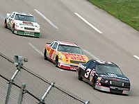 Dale Earnhardt (#3) leads Greg Sacks (#18) and Ken Schrader enroute to victory in the Winston 500 at Talladega in May, 1990. (Photo by Brian Cleary/www.bcpix.com)