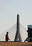 Man walking in foreground, Leonard P. Zakim-Bunker Hill Memorial Bridge viewed from Charlestown, City Square Park