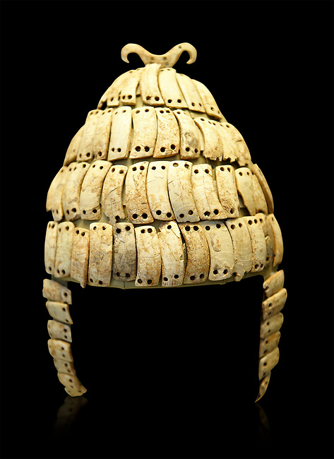 "Boar's tusk helmet with cheek guards and double bone hook on top. Tomb 515 Mycenae, Greece. 14th-15th century BC. National Archaeological Museum, Athens.. The Boar's tusk helmet was described in the Iliad as follows ""Meriones gave Odysseus a bow, a quiver and a sword, and put a cleverly made leather helmet on his head. On the inside there was a strong lining on interwoven straps, onto which a felt cap had been sewn in. The outside was cleverly adorned all around with rows of white tusks from a shiny-toothed boar, the tusks running in alternate directions in each row.<br /> —Homer, Iliad 10.260–5"""