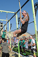 NWA Democrat-Gazette/FLIP PUTTHOFF<br /> CROSSFIT COMPETITORS<br /> Mollie Pate competes Saturday Sept. 5 2015 during a climbing event at the CrossFit Mid-America Championship at Tiger Stadium in Bentonville.  About 300 athletes from several states competed in weight-lifting and endurance events. The championship is a benefit for Guardians for Heroes, which helps veterans purchase gym memberships and exercise equipment, said Lee Kelly, owner of CrossFit NWA. Events continue at 8 a.m. today at the stadium. The public is invited to watch at no charge, Kelly said.