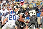 Palos Verdes, CA 09/24/10 - Daniel Walker (Serra #20), Joey Augello (Peninsula #58) and Tommy Webster (Peninsula #49)  in action during the Serra-Peninsula varsity football game at Peninsula High School.