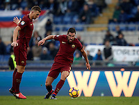 Calcio, Serie A: Lazio vs Roma. Roma, stadio Olimpico, 4 dicembre 2016.<br /> Roma&rsquo;s Kevin Strootman, right, flanked by his teammate Edin Dzeko, in action during the Italian Serie A football match between Lazio and Rome at Rome's Olympic stadium, 4 December 2016. Roma won 2-0.<br /> UPDATE IMAGES PRESS/Isabella Bonotto