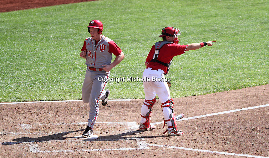 Scotty Bradley scores to give Indiana the lead in the fourth inning. Indiana's 6-2 win eliminated Nebraska from the Big Ten Tournament at TD Ameritrade Park in Omaha, Neb. on May 26, 2016. (Photo by Michelle Bishop)