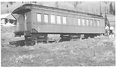 RGS outfit coach #0252 on cribbing at Trout Lake.<br /> RGS  Trout Lake, CO  Taken by Maxwell, John W. - 6/2/1964