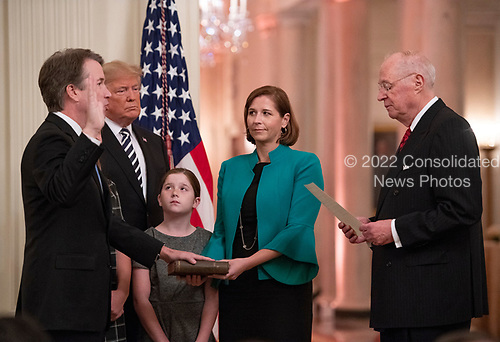 As his family and United States President Donald J. Trump look on, Associate Justice of the Supreme Court Brett Kavanaugh takes the Judicial Oath from former Associate Justice of the Supreme Court Anthony M. Kennedy during a ceremonial swearing-in ceremony in the East Room of the White House in Washington, DC on Monday, October 8, 2018.  Kavanaugh formally took the oath on Saturday, hours after he was confirmed by the US Senate.  <br /> Credit: Ron Sachs / CNP<br /> (RESTRICTION: NO New York or New Jersey Newspapers or newspapers within a 75 mile radius of New York City)