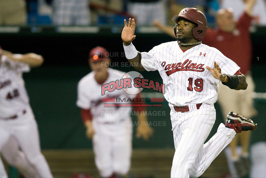 South Carolina's Jackie Bradley Jr. in Game 10  scores the winning run of the NCAA Division One Men's College World Series on June 24th, 2010 at Johnny Rosenblatt Stadium in Omaha, Nebraska.  (Photo by Andrew Woolley / Four Seam Images)