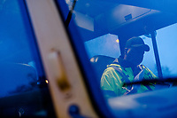Johnny Crudup (CQ), a full-time substitute bus driver for Wake County does paper work between bus routes in Raleigh, NC on Friday, March 31, 2017. (Justin Cook for The Wall Street Journal)<br /> <br /> BUSES Summary<br /> A shortage of school bus drivers is forcing one of North Carolina&rsquo;s largest school districts to consider starting class as early as 7:10 a.m. and as late as 9:15 a.m. this fall, to give the limited number of drivers time to do three or more runs each morning.