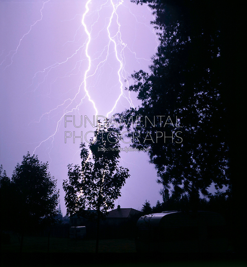 LIGHTNING STRIKE<br /> Tent in foreground<br /> Forked lightning occurs when a second lightning stroke doesn't follow the same path as the first lightning strike.