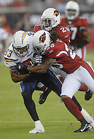 Aug 25, 2007; Glendale, AZ, USA; San Diego Chargers wide receiver Vincent Jackson (83) is tackled by Arizona Cardinals cornerback Eric Green (25) at University of Phoenix Stadium. San Diego defeated Arizona 33-31. Mandatory Credit: Mark J. Rebilas-US PRESSWIRE
