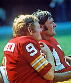 Washington Redskins quarterback Sonny Jurgensen (9), left, speaks to coaches in the press box as he sits on the bench with fellow quarterback Billy Kilmer (17), right, during a game against the San Diego Chargers at RFK Stadium in Washington, D.C. on August 25, 1973.  The Redskins won the game 38 - 0..Credit: Arnie Sachs / CNP