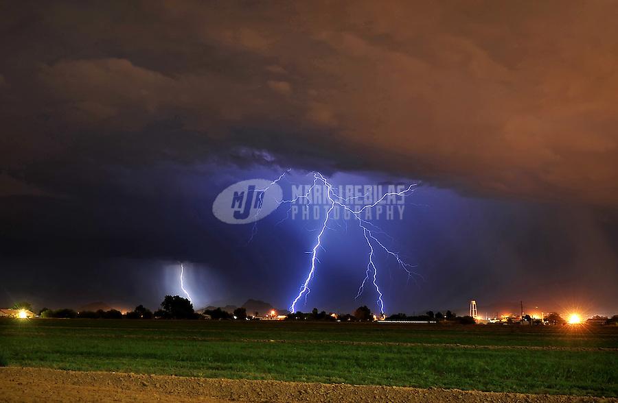 desert weather storm chaser chasing clouds sky Arizona night lightning strike bolt farm farmland field rain monsoon thunderstorm