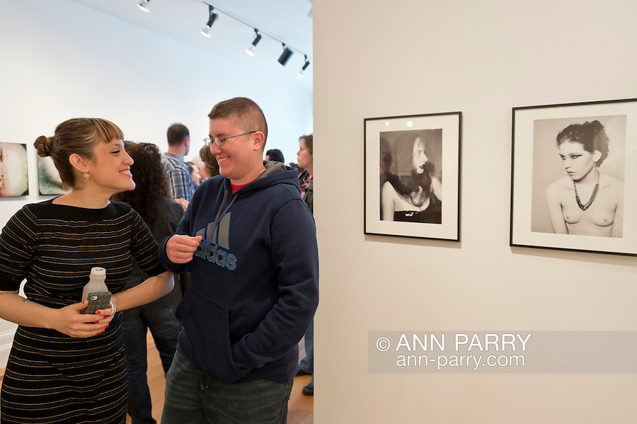 May 4, 2013 - Huntington, New York, U.S. - Artist LAUREN WEISSLER, left, and visitor are next to two of Weissler's photographs in her 'belle arme' exhibit, at the Opening Reception at fotofoto Gallery, a cooperative photography gallery which is a non-profit organization.