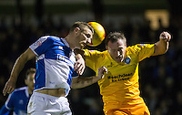 Garry Thompson of Wycombe Wanderers & Lee Brown of Bristol Rovers battle for the ball during the Sky Bet League 2 rearranged match between Bristol Rovers and Wycombe Wanderers at the Memorial Stadium, Bristol, England on 1 December 2015. Photo by Andy Rowland.