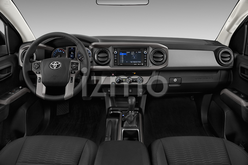 Stock photo of straight dashboard view of a 2018 Toyota Tacoma SR5 Access Cab 4 Door Pick Up