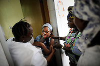 Isattu Jalloh, 11, is given an injection at the St John of God hospital in Lunsar, Sierra Leone. The girl is 7 months pregnant and will deliver via C-Section after a grassroot organization took her from her family and had her examined by a doctor for the first time. She was raped by her uncle who thought her sexually mature after circumcision.