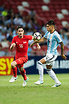 Carlos Correa of Argentina (R) fights for the ball with Daniel Bannett of Singapure (L) during the International Test match between Argentina and Singapore at National Stadium on June 13, 2017 in Singapore. Photo by Marcio Rodrigo Machado / Power Sport Images