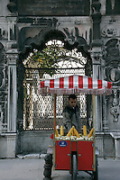 Selling corn on the cob next to an Ottoman tomb in Eminonu, Istanbul, Turkey