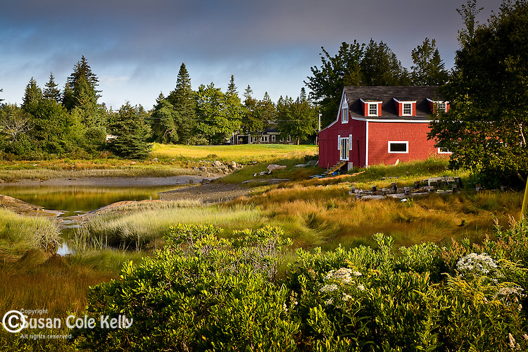 A red boathouse at Crockett Cove, Stonington, ME, USA