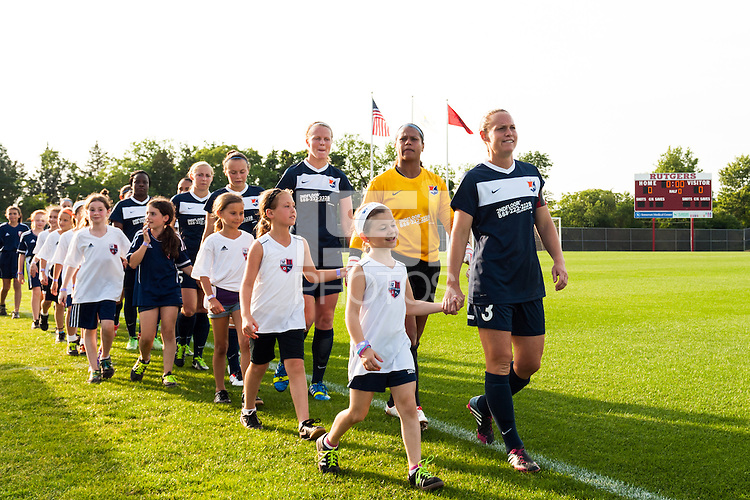 Sky Blue FC defender Christie Rampone (3) leads the team out for pre-game introductions. Sky Blue FC and the Portland Thorns played to a 0-0 tie during a National Women's Soccer League (NWSL) match at Yurcak Field in Piscataway, NJ, on June 22, 2013.