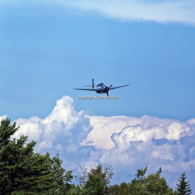 US Navy Avenger bomber flying at the Owls Head Transportation Museum, Owls Head, Maine, USA