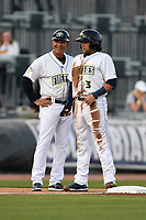 Second baseman Blake Tiberi (3) of the Columbia Fireflies is greeted at third base by manager Pedro Lopez in a game against the Augusta GreenJackets on Opening Day, Thursday, April 5, 2018, at Spirit Communications Park in Columbia, South Carolina. Columbia won, 4-2. (Tom Priddy/Four Seam Images