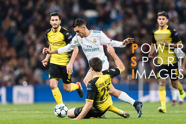 Daniel Ceballos of Real Madrid (L) fights for the ball with Borussia Dortmund Defender Sokratis Papastathopoulos (R) during the Europe Champions League 2017-18 match between Real Madrid and Borussia Dortmund at Santiago Bernabeu Stadium on 06 December 2017 in Madrid Spain. Photo by Diego Gonzalez / Power Sport Images