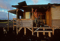 Baba Tabilangan poses for a portrait in his beachfront shack on Molokai island in 1995. ``I've been in jail for the last seven years,'' he explained.``My old lady just left me, but I'm not going to go chase her back. I'm a legend in my own time.''