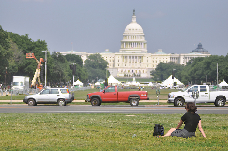 "Liz Alspector, an intern, holds a spot on the grass of the National Mall for the softball team ""The Branch"". Wednesday June 3, 2009"