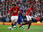 Marouane Fellaini of Manchester United cleans up the loose ball during the English Premier League match at Old Trafford Stadium, Manchester. Picture date: April 16th 2017. Pic credit should read: Simon Bellis/Sportimage