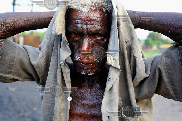 An old man who has spent much of his life illegally scavenging coal from an open cast mine. They inhale endless coal dust but it earns them more than they would as day labourers working for the mine's operators. /Felix Features