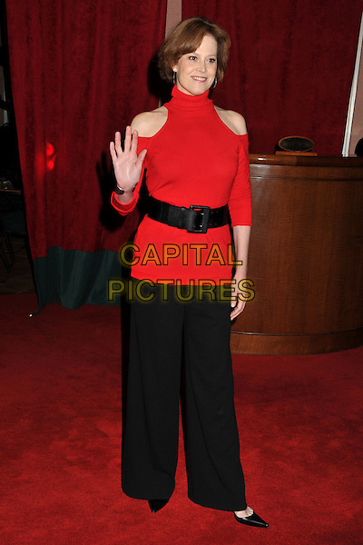 SIGOURNEY WEAVER .17th Annual Women in Entertainment Power 100 Breakfast at the Beverly Hills Hotel, Beverly Hills, California, USA..December 5th, 2008.full length top shoulder cut away out black belt wide leg flared trousers red high collar polo neck turtleneck hand palm waving .CAP/ADM/BP.©Byron Purvis/AdMedia/Capital Pictures.