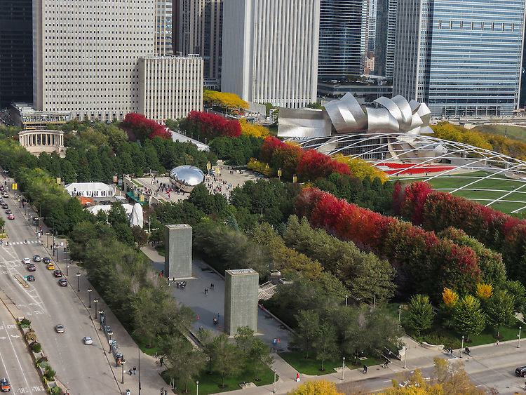 Fall foliage surrounds the Wrigley Square and Millennium Park Monument (upper left), the Cloud Gate sculpture, the Jay Pritzker Pavilion (upper right) and the Crown Fountain (bottom left) in downtown Chicago's Millennium Park. (DePaul University/Jamie Moncrief)